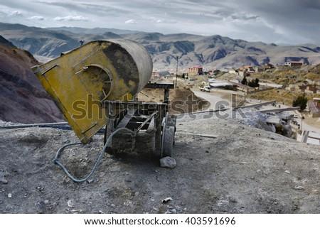 Empty mine cart at the entrance of Cerro Rico silver mine, Potosi, Bolivia - stock photo