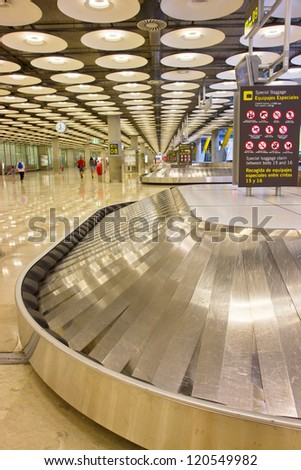 empty modern luggage belt in the airport - stock photo