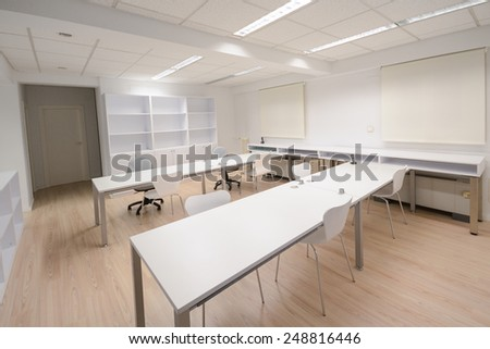 Empty modern office with white furniture - stock photo