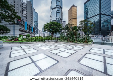 Empty modern square and office buildings - stock photo