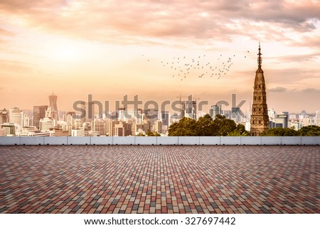 empty, modern square and skyscrapers in modern city under sunset - stock photo