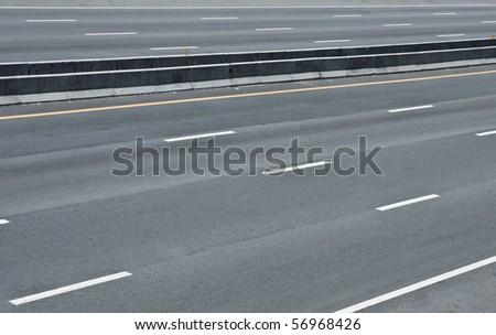 Empty motor way parallel road - stock photo