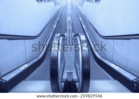 Empty moving escalator stairs in the supermarket. - stock photo