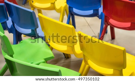 empty multicolor plastic chairs school classroom stock photo