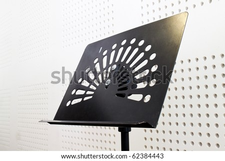 empty music stand in soundproof room - stock photo