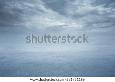 Empty nature background, frozen lake with dramatic sky - stock photo
