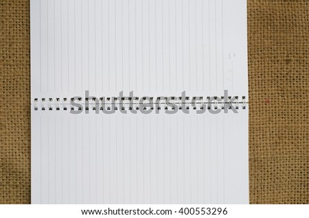 empty note book on sackcloth background