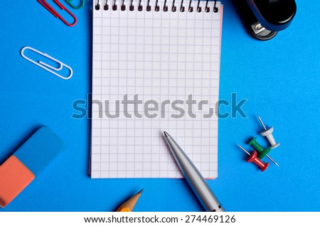 Empty notebook and office supplies - stock photo