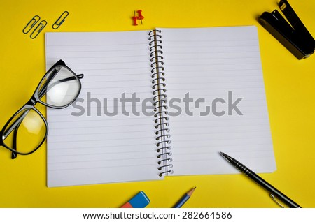 Empty notebook and office supply - stock photo
