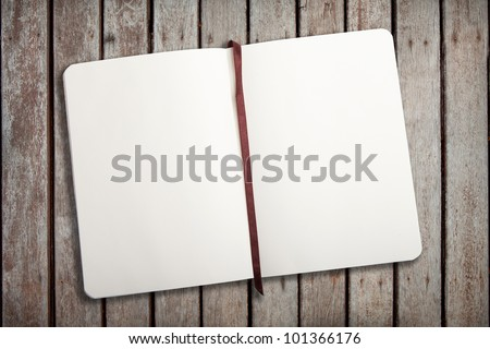 Empty notebook opened on wood-ground - stock photo