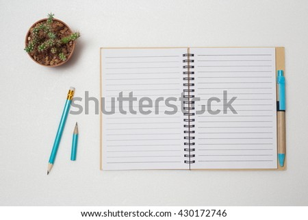 Empty notebook paper for text,Notebook paper for text and pen on white background,Top view - stock photo