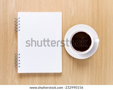 Empty notebook with coffee cup on wooden texture background. - stock photo