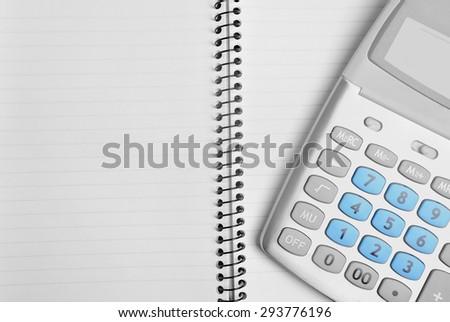 Empty notepad with calculator closeup - stock photo