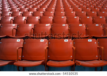 Empty numbered sport stadium seats - stock photo