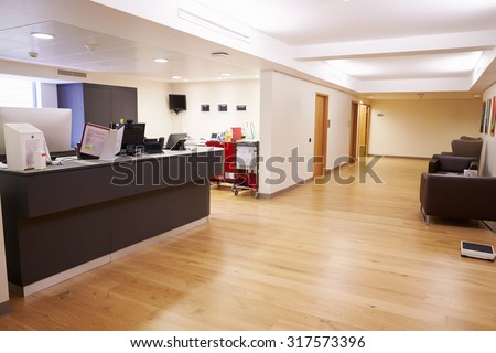 Empty Nurse's Station In Modern Hospital - stock photo