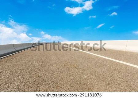 Empty of asphalt road in front of the blue sky - stock photo