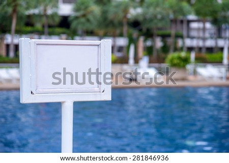 empty of sign standing near a swimming pool. - stock photo