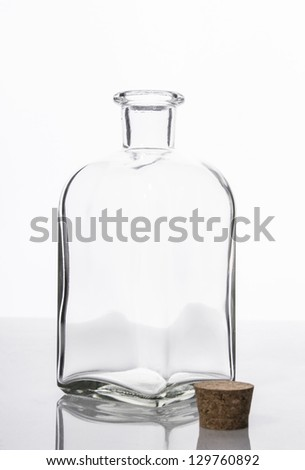 Empty old fashioned glass bottle with cork stopper - stock photo