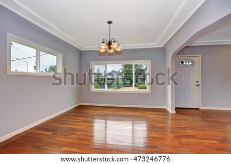Empty Old house interior. Entryway with hardwood floor and lavender walls. Northwest, USA