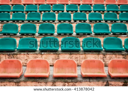 Empty old plastic seats at stadium, open door sports arena.