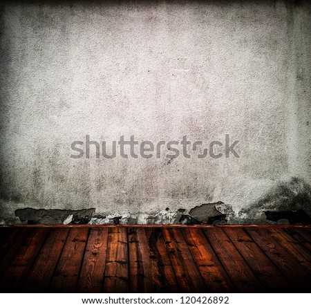 Empty old room with grunge wall and wooden floor - stock photo