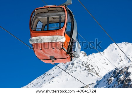 Empty old style gondola lift on ski resort - stock photo