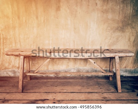 empty old wood chair and cement wall vintage