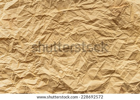 Empty old yellow crumpled paper texture, space for text - stock photo