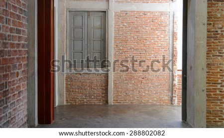 Empty on concrete wall and window in the old gallery - stock photo