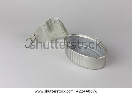 empty open tin can isolated on grey background, macro close up - stock photo