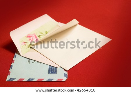 Empty opened  envelopes on red backgrounds - stock photo
