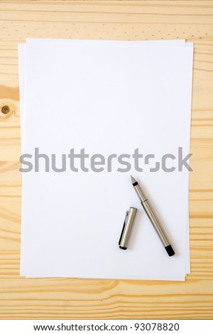 Empty or blank paper with pen - stock photo