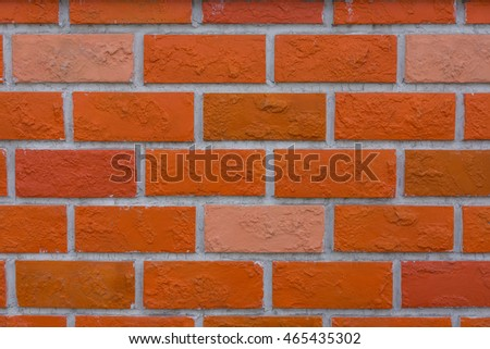 Empty orange  brick wall textured background.