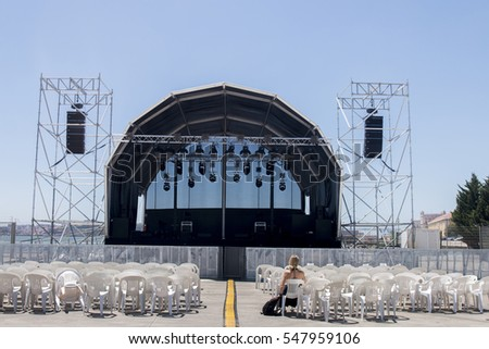 Empty outdoor concert stage on a sunny day.