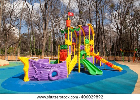 Empty outdoor modern design colorful attractive playground - stock photo
