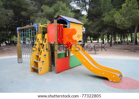 Empty Outdoor Playground for Children in Outdoor Picnic Area - stock photo