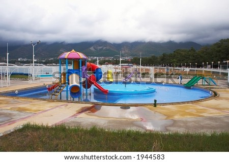 Empty paddling pool for children in an aquapark - stock photo