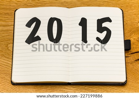 Empty pages of a notebook for 2015. Make the notes for a fresh start. Space for copy in textbook. - stock photo