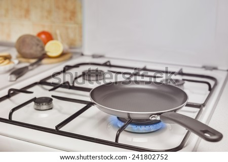 empty pan on the stove burning flame - stock photo