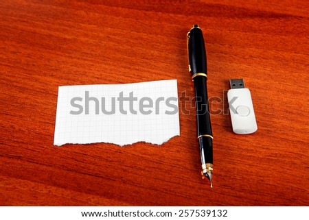 Empty Paper with the Pen and USB Drive on The Table - stock photo