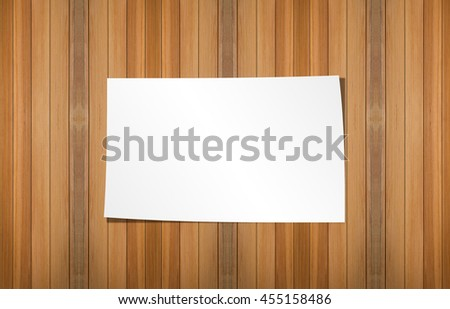 Empty papers on Wooden texture background.