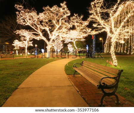 empty park bench at night  - stock photo