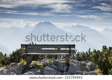 Empty park bench in high mountains, view from Eagles nest in the bavarian Alps near Berchtesgaden in Germany