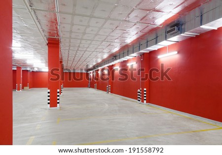 Empty parking area on  long and beautiful underground garage - stock photo