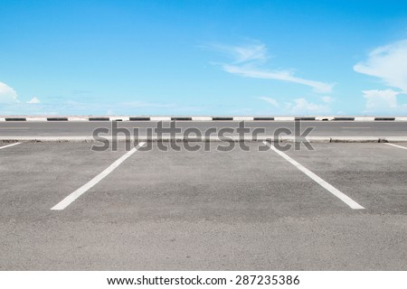 Empty parking area with sky landscape - stock photo