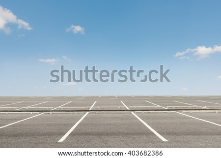 Empty parking lot on sunset background - stock photo