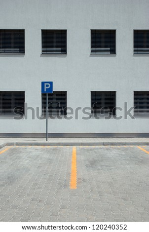 Empty parking lot with parking sign - stock photo