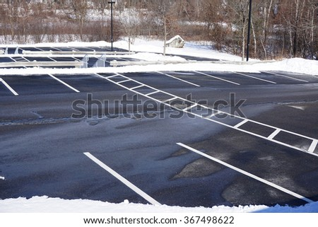 empty parking lot with snow removed - stock photo