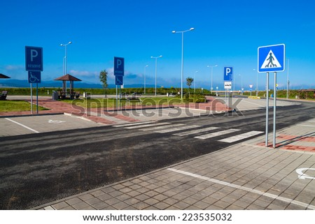 Empty parking near the highway on a clear autumn day - stock photo