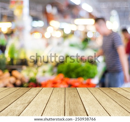 Empty perspective wood and blur market with bokeh background,  product display template. - stock photo